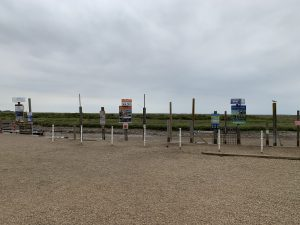 Carnser Pay and Display Car Park by seal trip boards on Quay